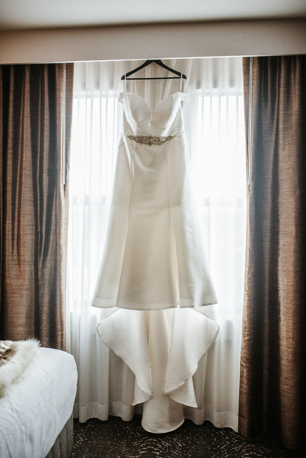 detail shot of wedding dress at the kimpton carlyle hotel
