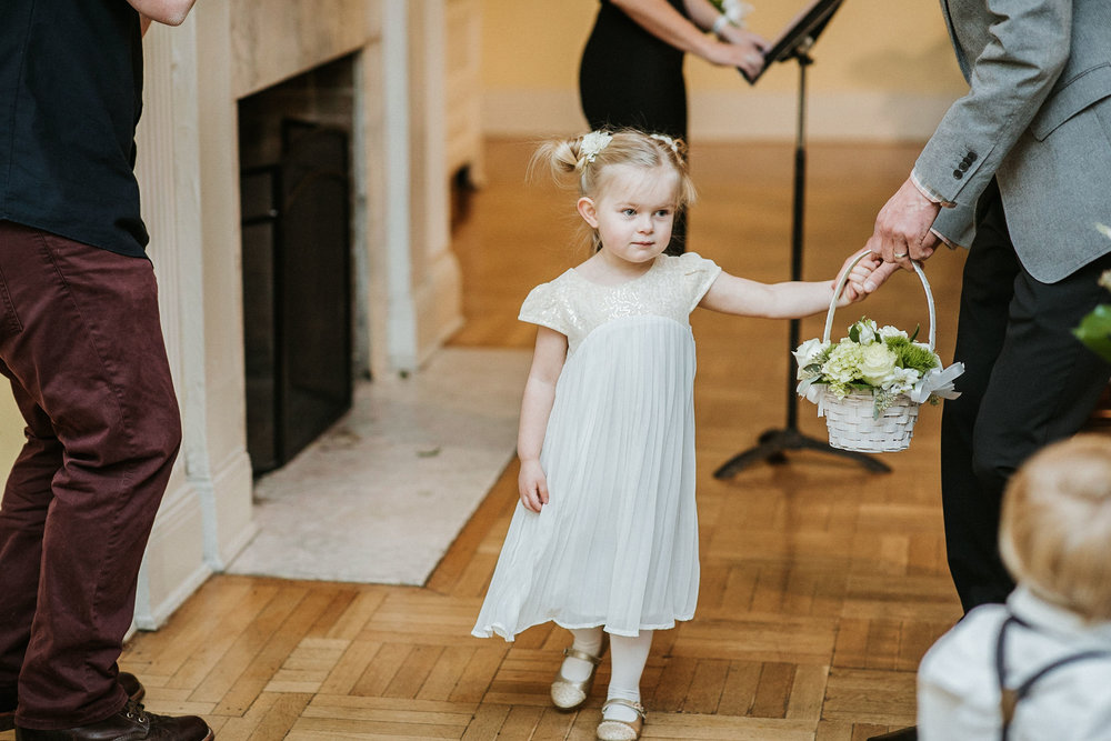 flower girl entering the ceremony at the josephine butler parks center