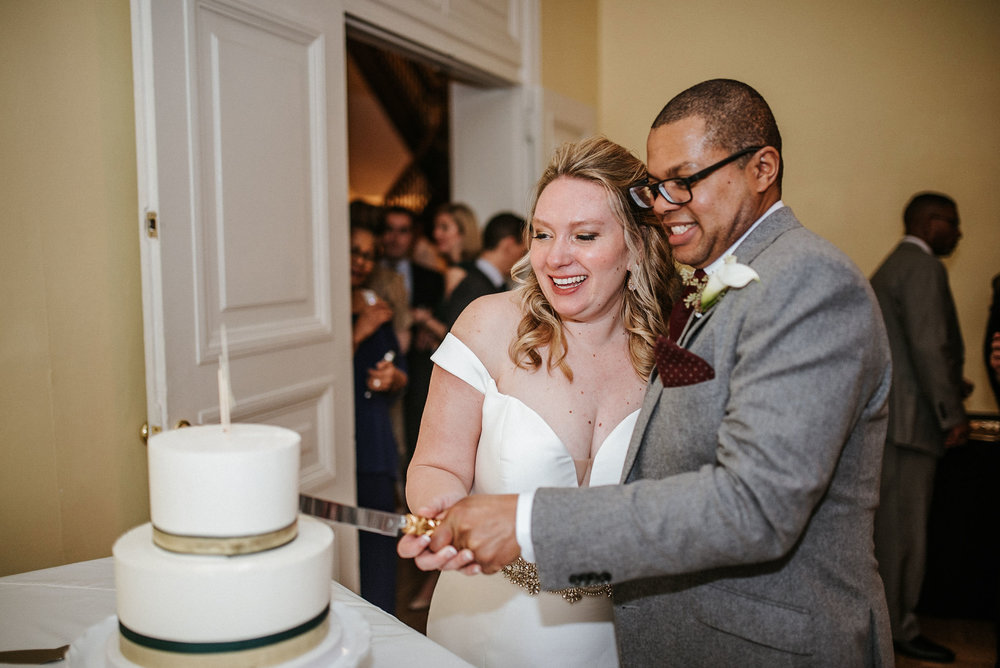 bride and groom cutting the cake at the josephine butler parks center
