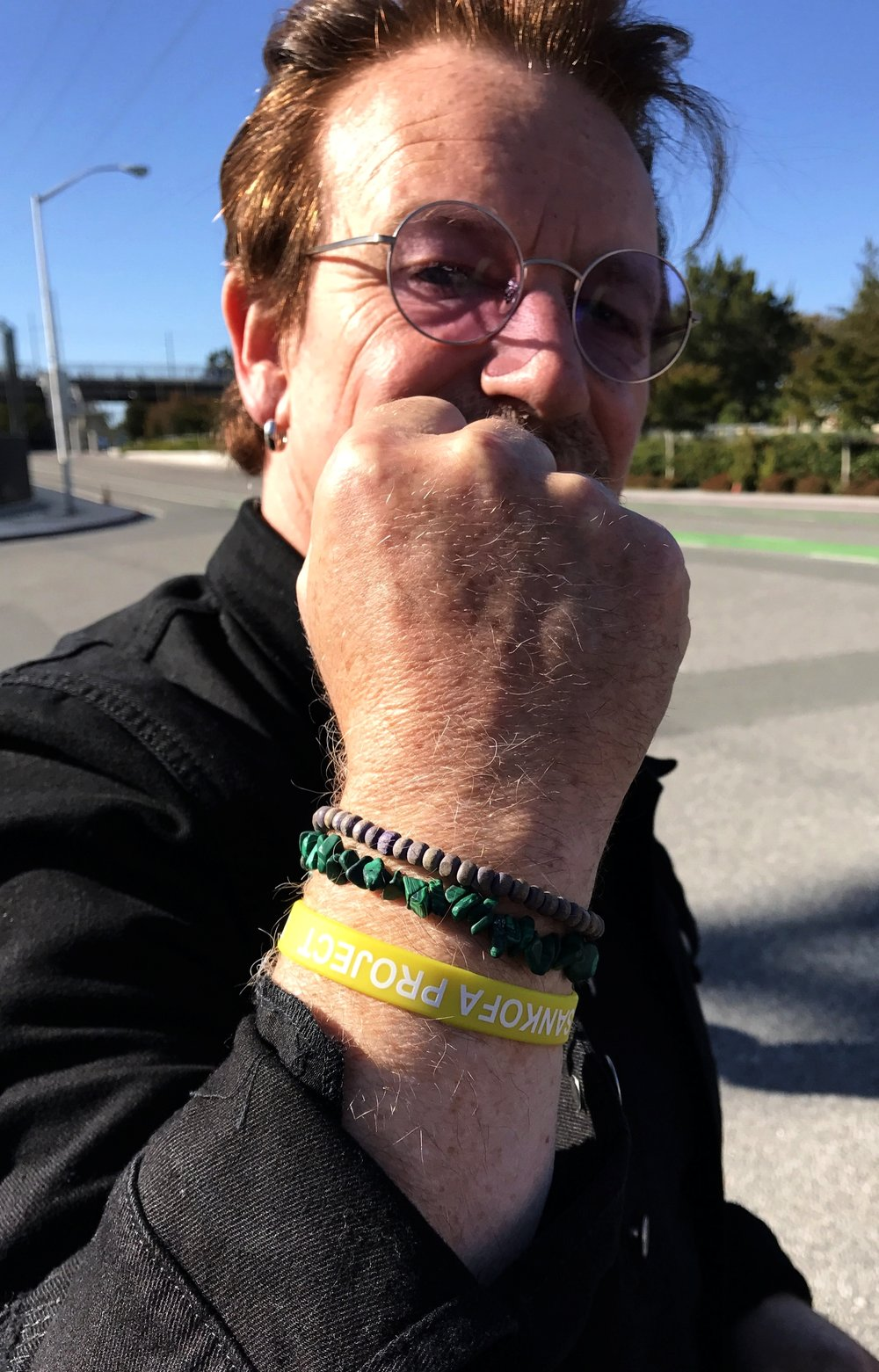 """Bono sporting our bracelets during the Joshua Tree Tour, 2017.At Second Chance Africa, we find resonance in the message of 'One' which urges us to recognize our shared humanity, and the need to """"carry each other' through a world embroiled with both suffering and beauty. Thank you Bono, for your enthusiasm and support over the years!"""
