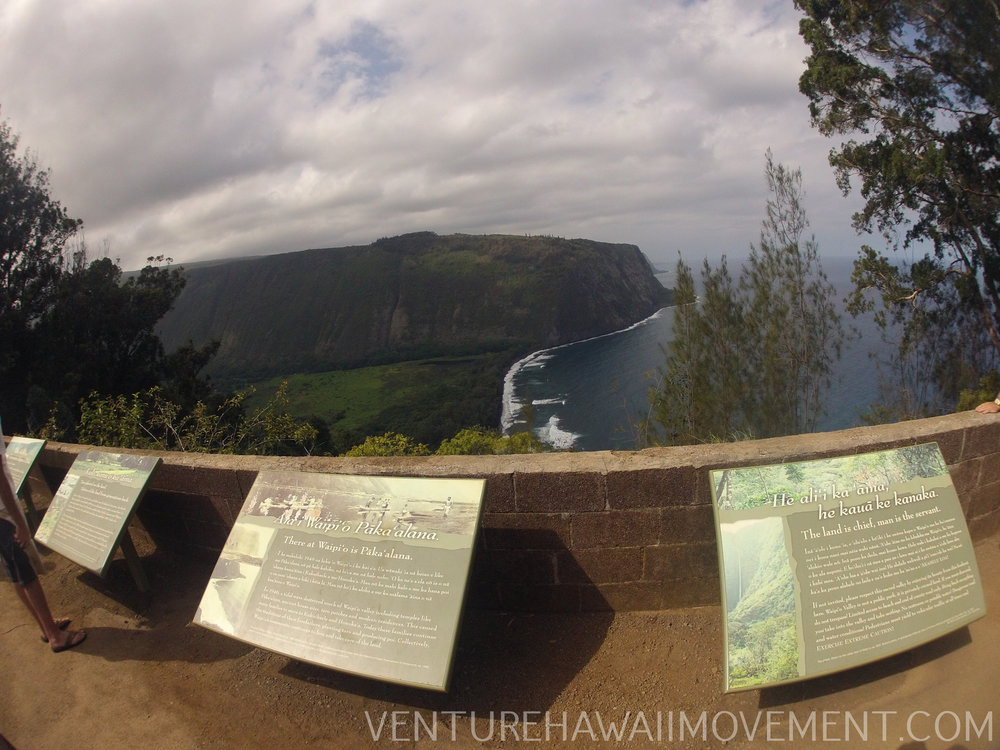 Waipio Valley Lookout  - Wapio Valley on the Big Island of Hawai'i is a popular tourist location. With a beautiful view overlooking the valley, Wailoa Stream and black sand beach. In the heart of the valley there is a 1,450 foot waterfall, Hi'ilawe Falls.