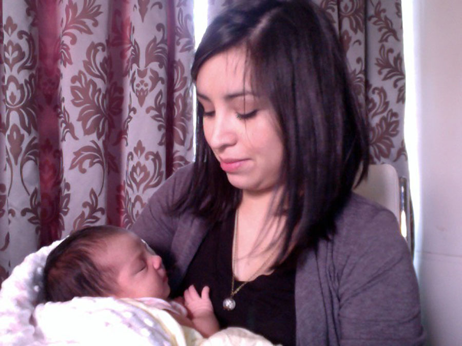 At a mere 21 days old, I cuddled with my little one while I waited for my first bride and groom meeting of the new 2013 year. She was tiny and slept so well.