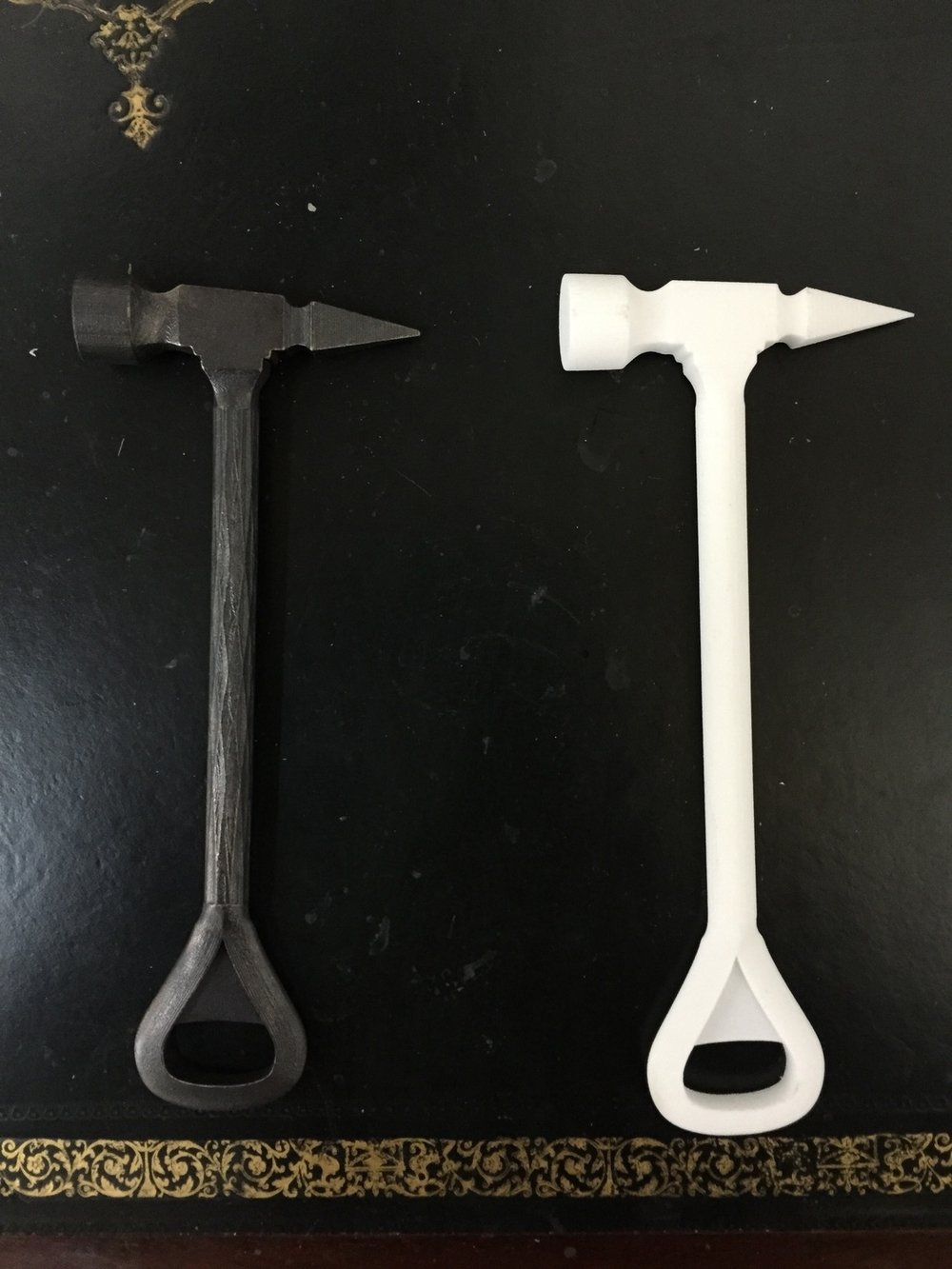 The metal and plastic bar-tool prototypes.