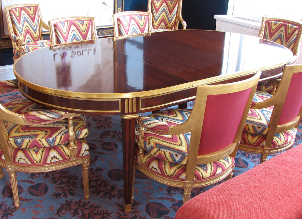 Extending dining table with gilt custom hardware for Alex Papachristidis by   Victoria & Son