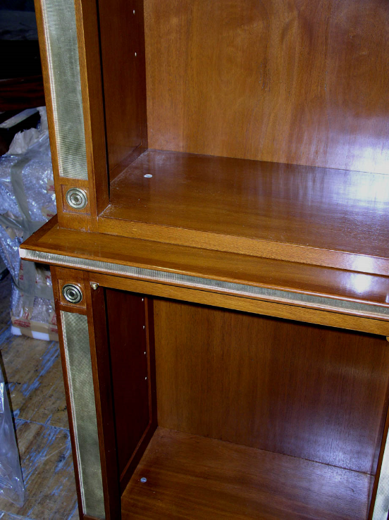 Detail of the match-strike brass and brass rosettes used for this cabinet