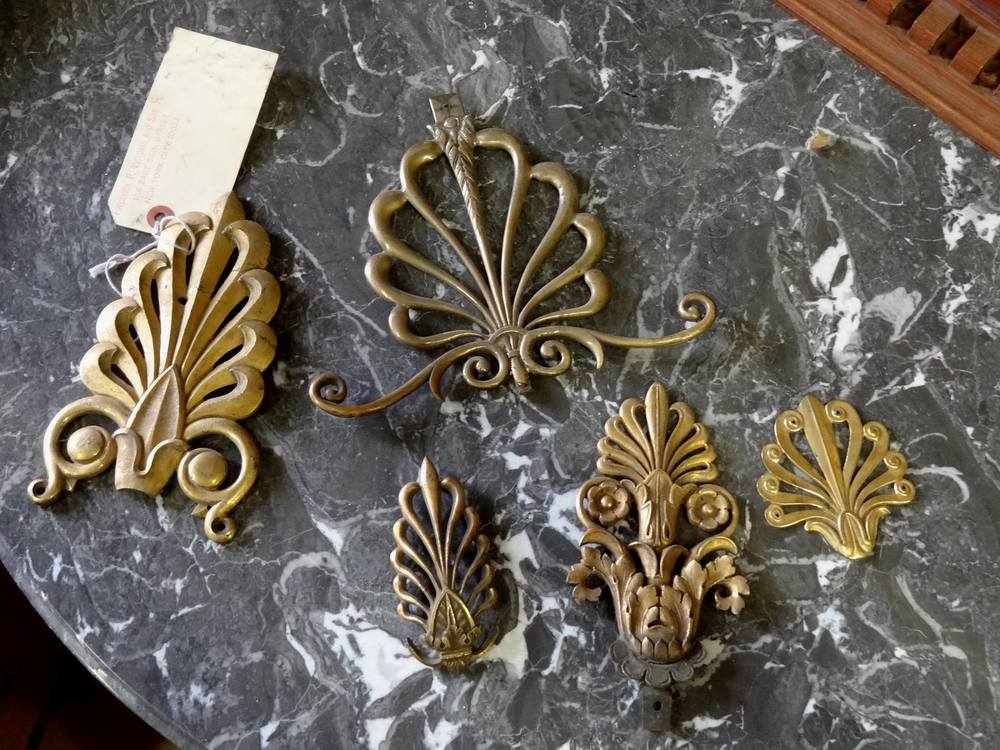 Some brass anthemion from our collection of mounts which weused as inspiration for our anthemion design