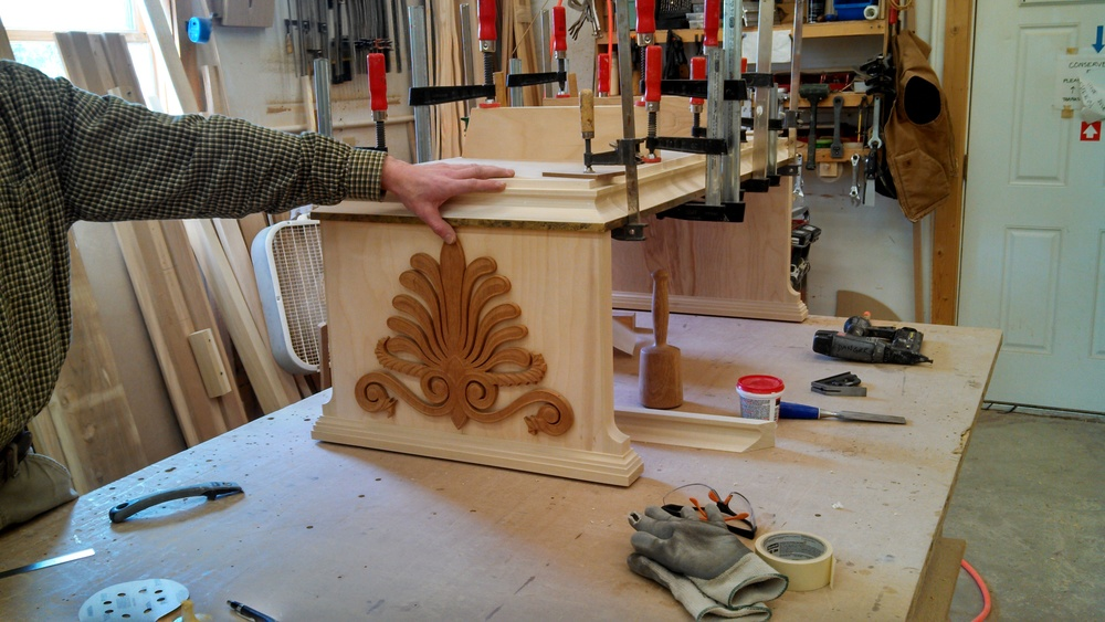 Assembling the table with the finial carving