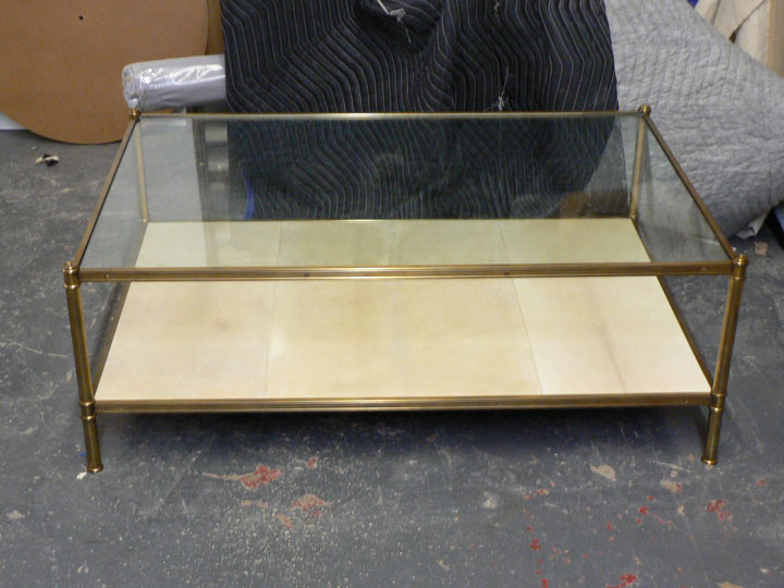 A custom size Cole Porter coffee table with glass and parchment shelves