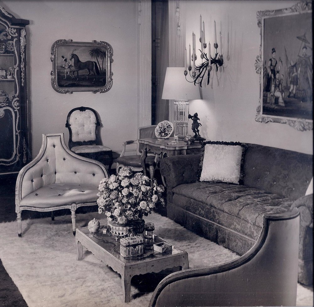 A circa 1950photo of Fred Victoria's early apartment in the Dakota including a pair of corner bergeres and many other pieces made by his firm.