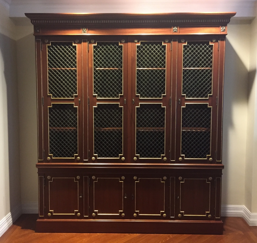 Victoria & Son Louis XVI style bookcase, model R650, in mahogany with gold leaf details.