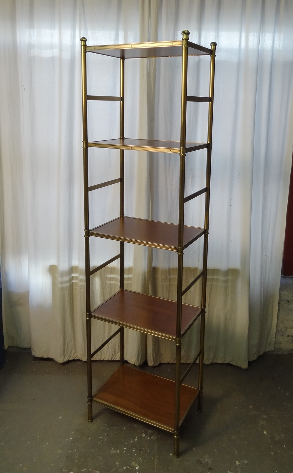 A narrow Cole Porter etagere by Victoria & Son