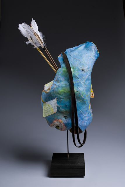 Eros. Front.  Mixed Media-paper and plaster, oil, gouache, leather, cowhide, feathers, inks, wire. 14 x 29 x 20.   A sculpture about hunting for love; being possessed by a feeling that shakes the soul, loosens the limbs, and clouds judgement.