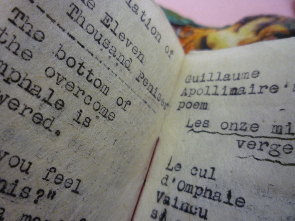 "Omphale Queen of Lydia. Detail Artist Book. Apollinaire Poem, ""Les Onze Mille Verges.""   Artist book on back of sculpture contains this poem as well as stories about the erotic escapades of Omphale and Hercules."