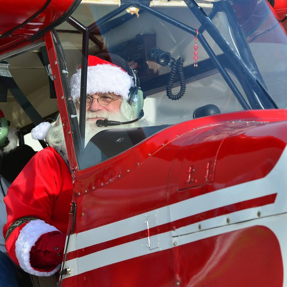 Santa at Paws & Planes Holiday Edition at Frederick Airport