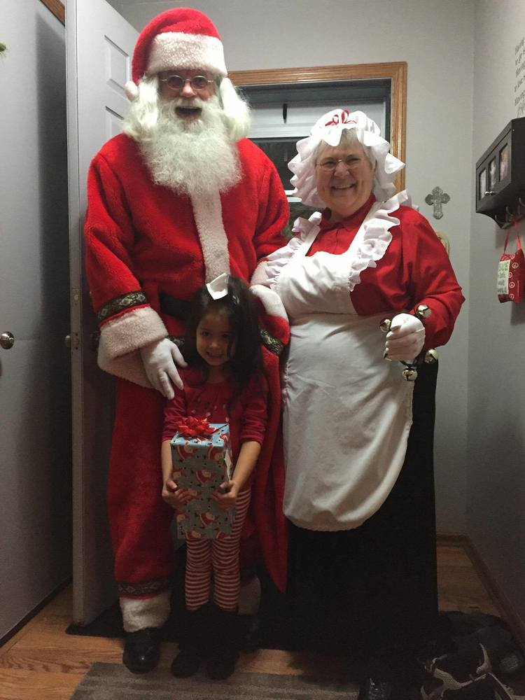 Santa & Mrs. Claus visit a good little girl in her home.