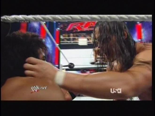 Bo Dallas takes a moment to feel on Xavier Woods' weave.