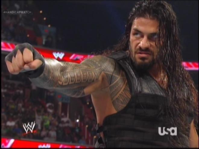Roman Reigns giving his imaginary friends the sign of unity.