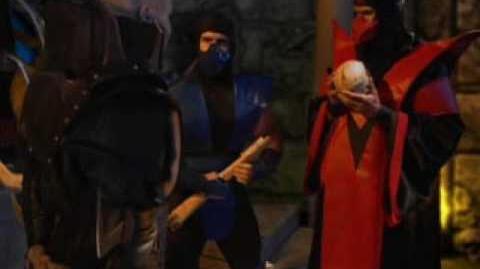 The Lin Kuei Grandmaster has the same fashion sense as the Grand Wizard of the KKK.
