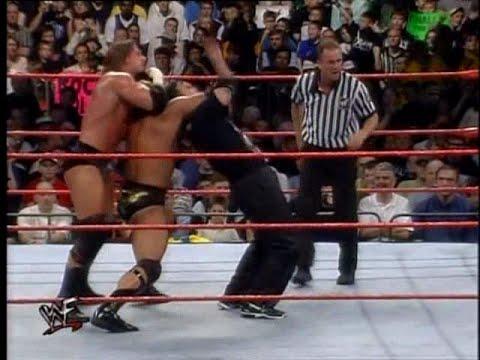 Resultado de imagem para insurrextion 2000 the rock vs triple h vs shane mcmahon