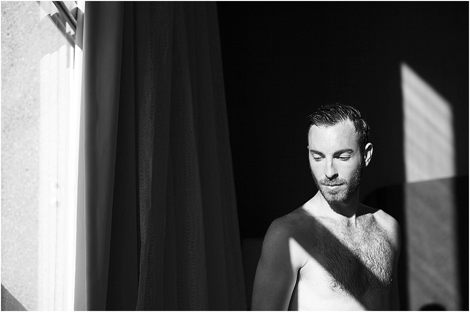 sexy dudeoir portrait with direct sunlight through the window