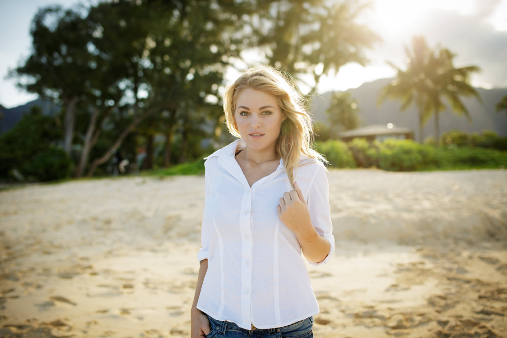 beautiful portrait of woman at sunset at hawaii beach