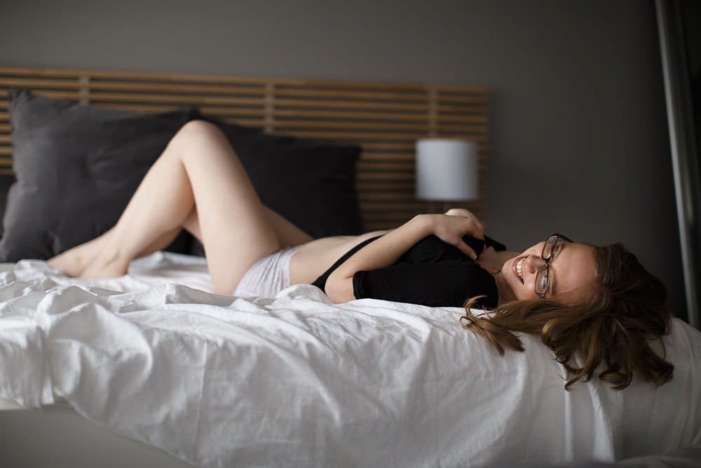 Los Angeles, CA boudoir model laying on a bed