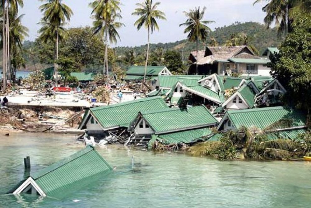 tsunami damages homes in thailand