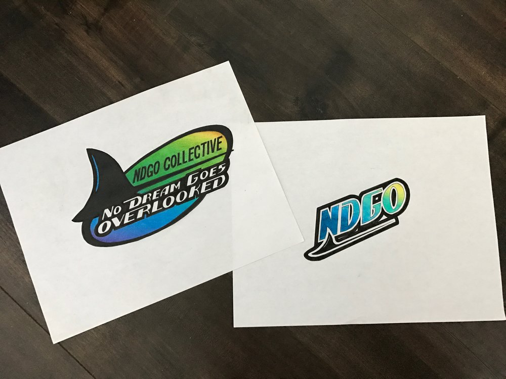 Almost five years ago, when we started NDGO Collective, I always envisioned myself doing a play on the Tampa Bay Devil Rays logo. Since I was a little kid, I was always intrigued by that old logo, I don't know if it was the colors or what. Fast forward to March 2017, my girlfriend CC, brought what I envisioned at the start to life. The original Devil Rays logos literally had a Devil Ray in them, but I love waves so I had CC chop it into a black wave aka the Devil Wave.