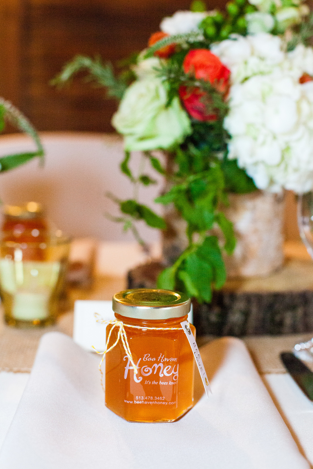 Bee Have honey jars on tables at our wedding last  month (flowers via Eden Floral Boutique)