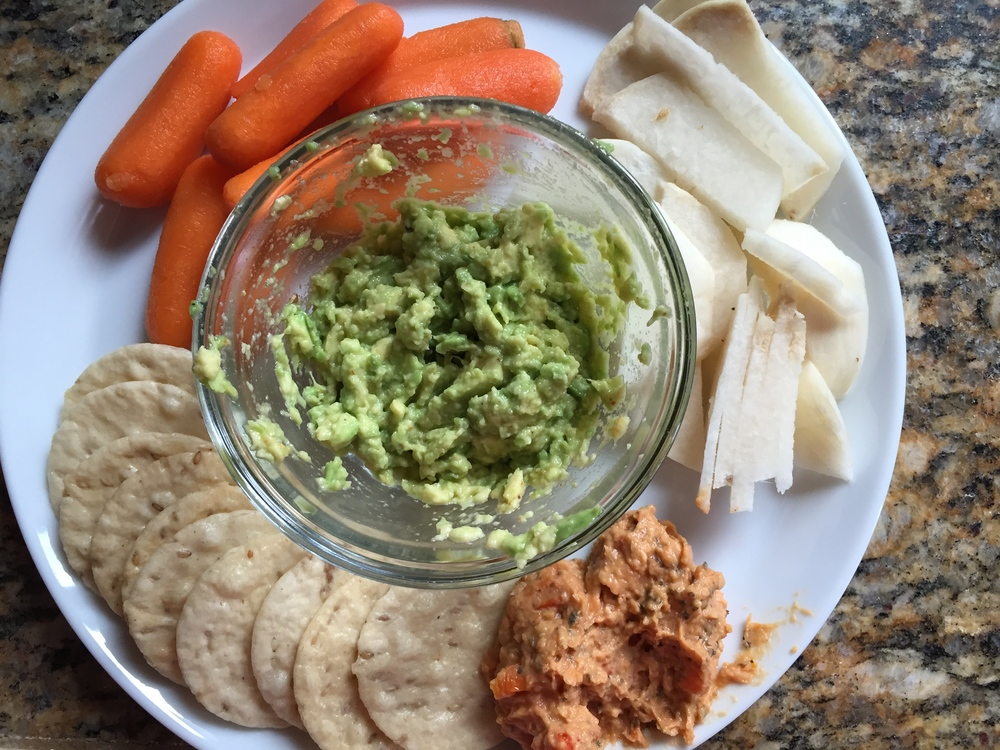 "carrots, jicama, ""guac"", rice crackers and roasted red pepper hummus"