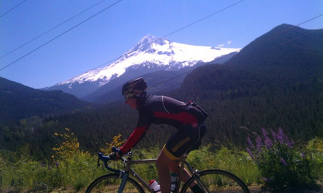 riding over Lolo Pass, Mt Hood in the background, 2011. Photo by Greg Sanders