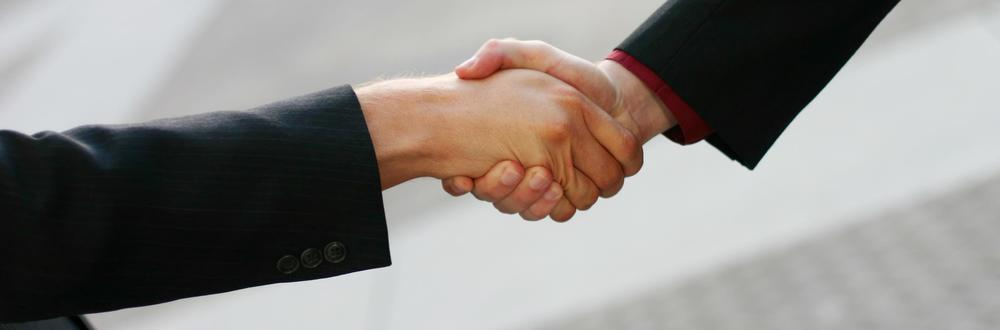 obligitory business handshake photo