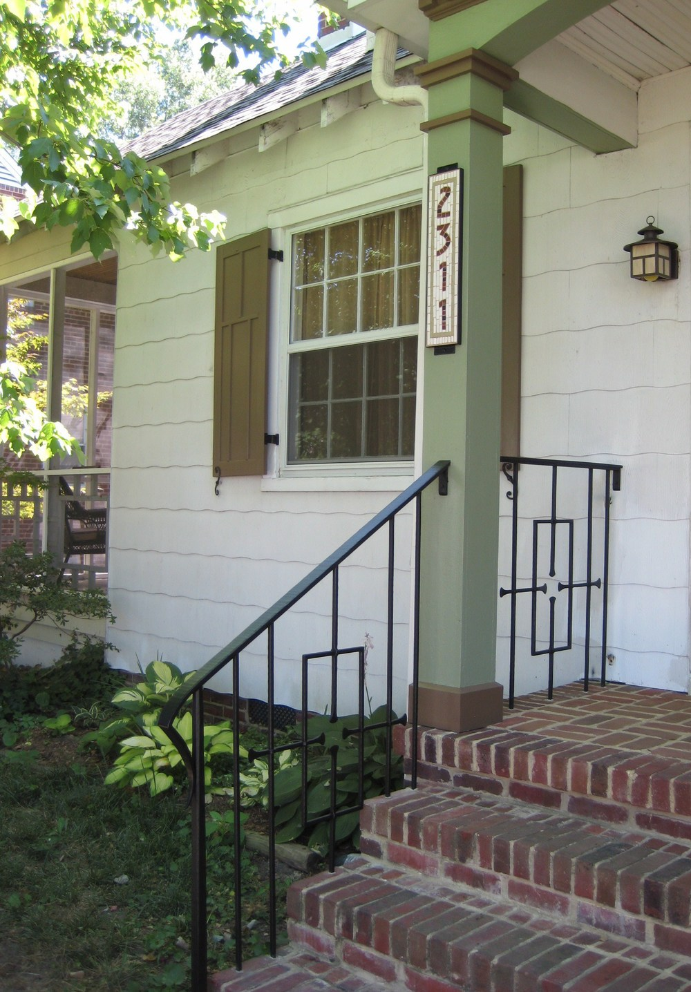 Porch hand rail, mosaic address plaque, & shutters