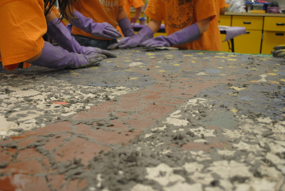 Grouting the mosaic panels