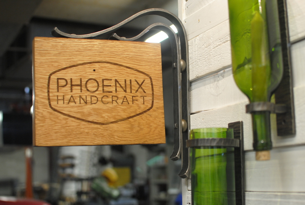 Our new logo on a laser-cut sign created for us by  Big Secret