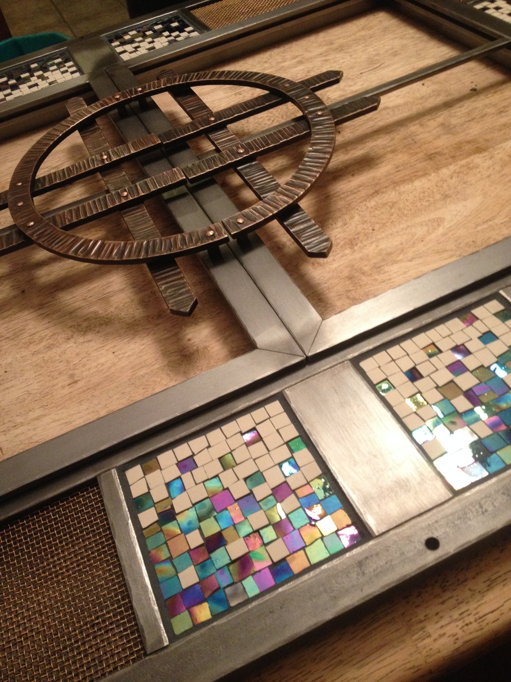 Custom firescreen with mosaic panels and forged bronze handles in process