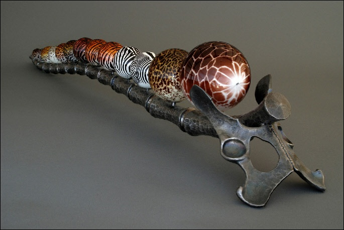 """Animal Spine: Life and Death"", approximately 11""h x 52""w x 9""d. Glass spheres by Mark Matthews, forged steel by Joel Sanderson."