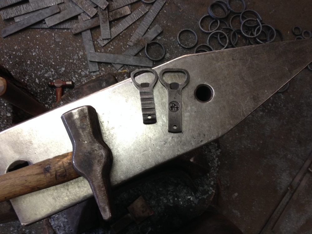 Bottle openers hot off the anvil.