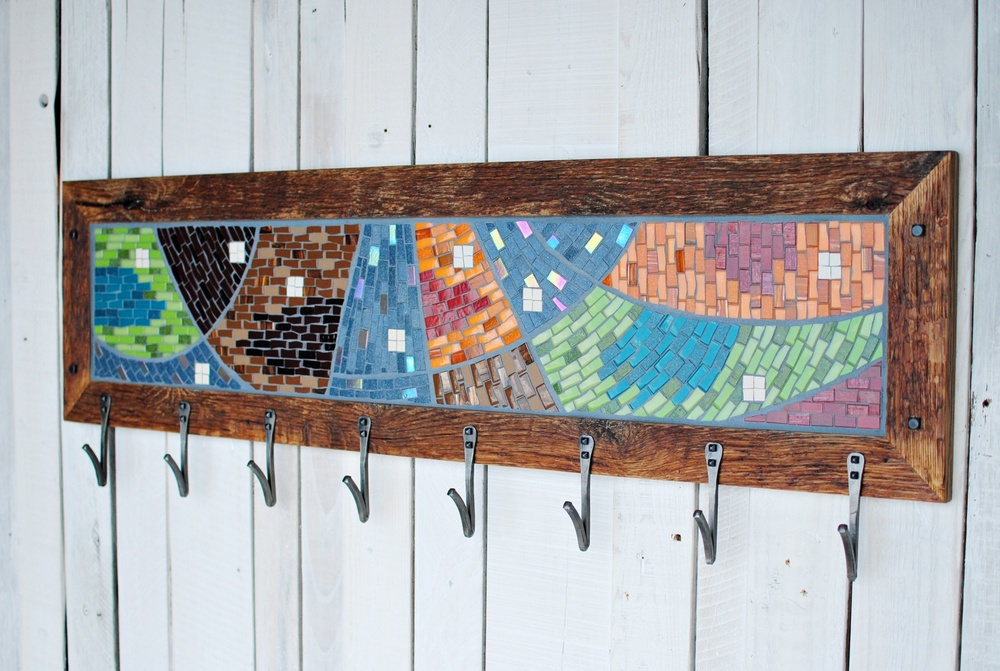 Kyle created a reclaimed wood frame twice as wide as our usual frames to support both the physical and visual weight of the mosaic. He added his V-style hand-forged hooks to complete the piece.