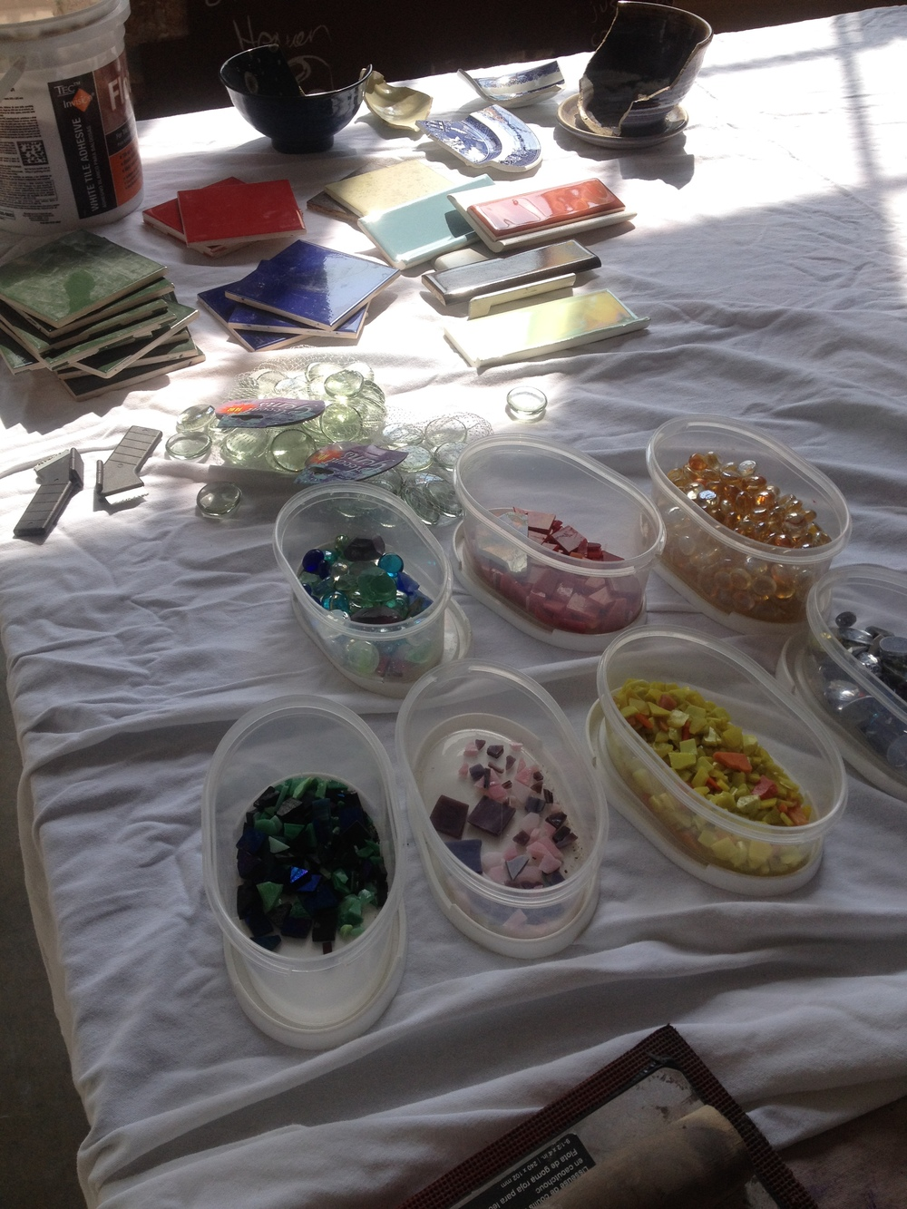 We worked with a mix of stained glass mosiac tiles, glass marbles, ceramic tiles, and reclaimed ceramic dishes.