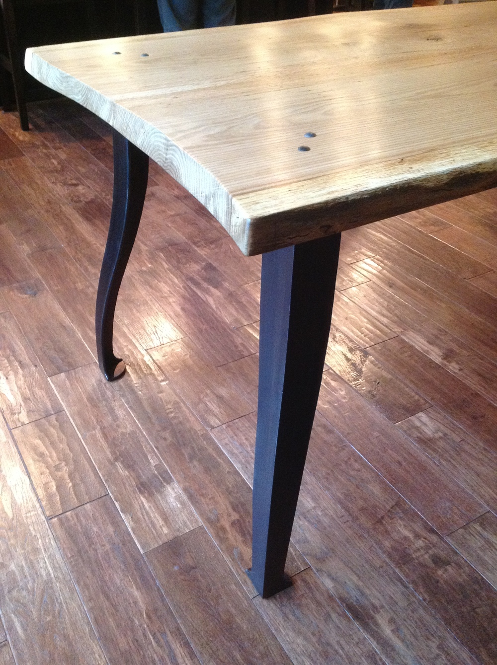 Clawhammer-dining-table-forged-legs.jpg