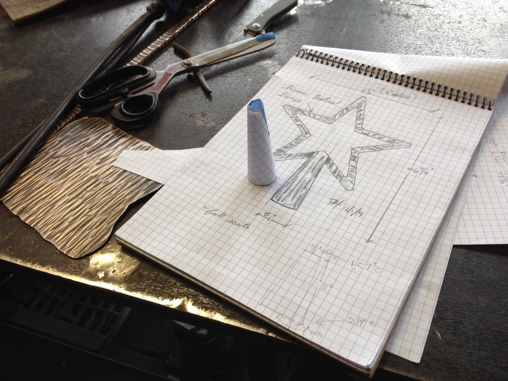 After laying out the  frust  um , he created a paper template to confirm his calculations of the measurements of the base.
