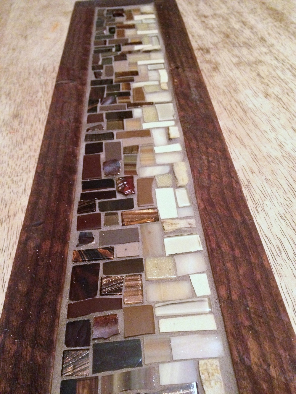 Custom mosaic coat rack in brown
