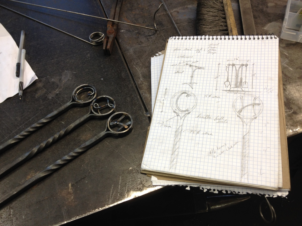 Hand forged monogrammed fireplace tool set in progress in the metal studio