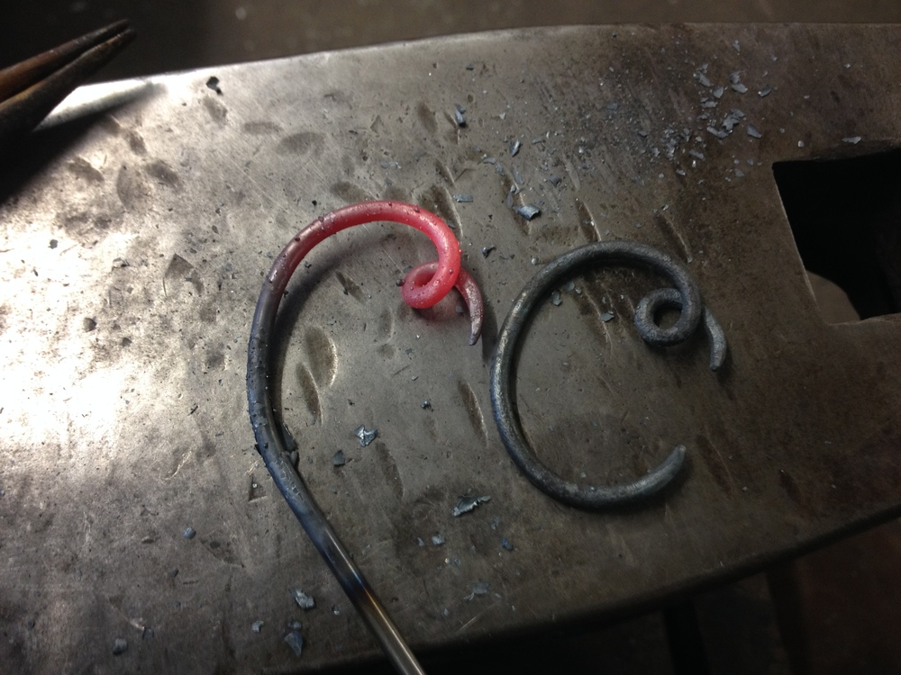 Forging initials for a personalized set of fireplace tools