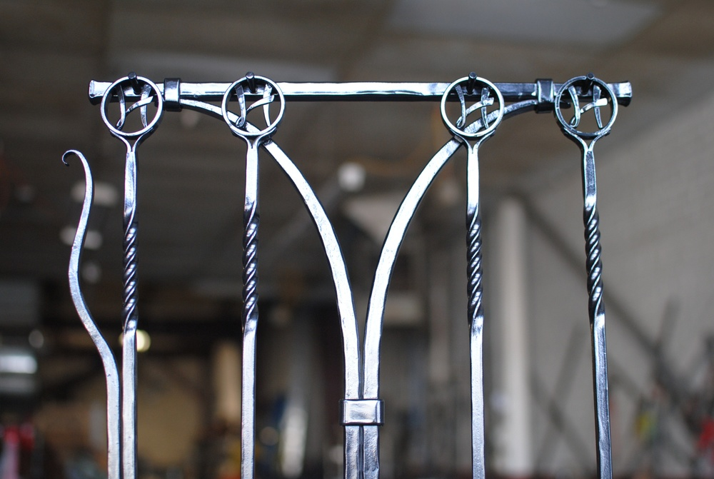 Monogram detail of custom hand forged fireplace tool set