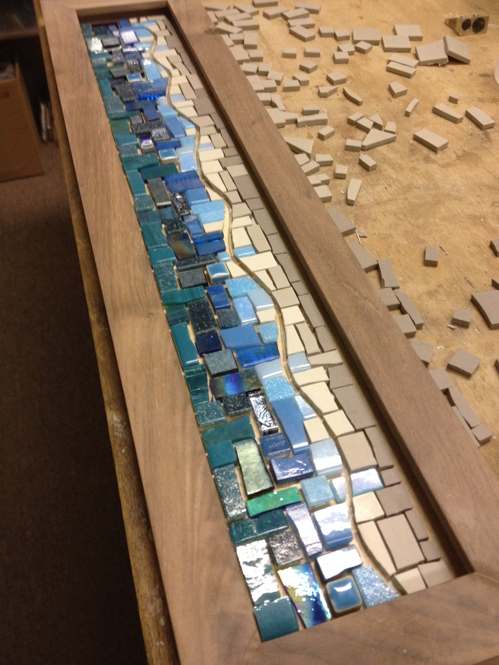 Custom mosaic coat rack in blues and grays