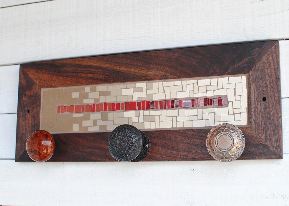Custom mosaic coat rack with vintage door knobs for hooks