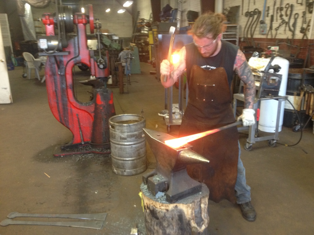 Forging door hinges for Stone Brewery