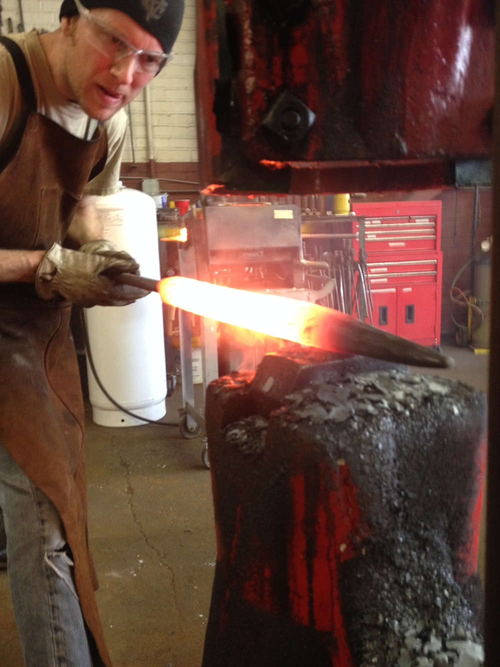 Forging custom door handles for Stone Brewery on the power hammer